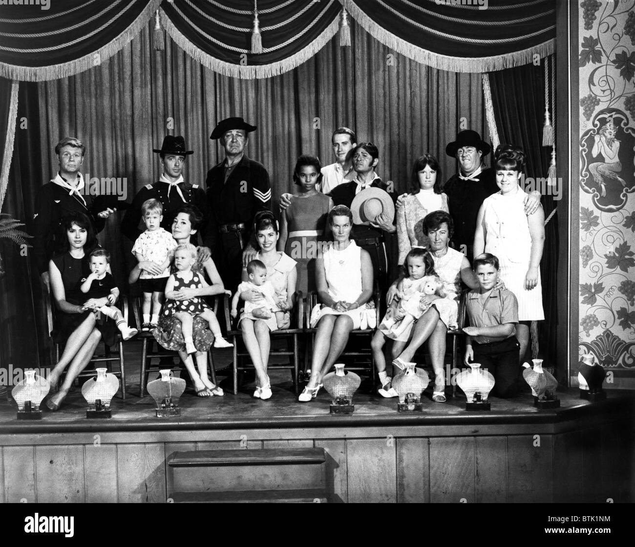 F TROOP, cast and their families on the set. James Hampton, Ken Berry, Forrest Tucker, Larry Storch, Joe Brooks, - Stock Image