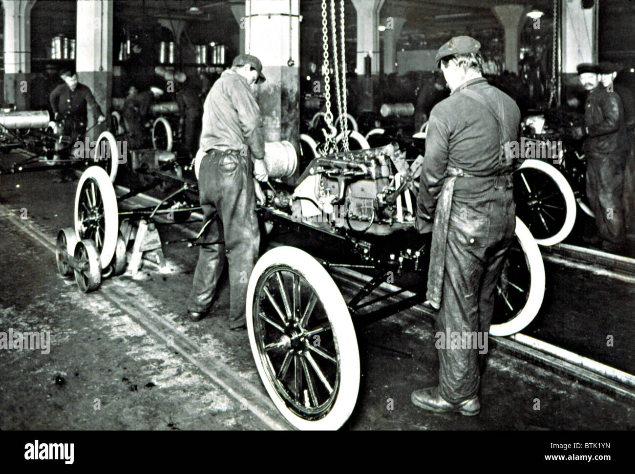 Ford motor company in the early 1900s showing the assembly line