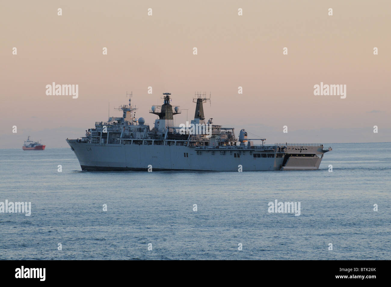 HMS Albion L14 outbound from Portsmouth England early evening light. The ship is a LPD Landing Platform Dock - Stock Image