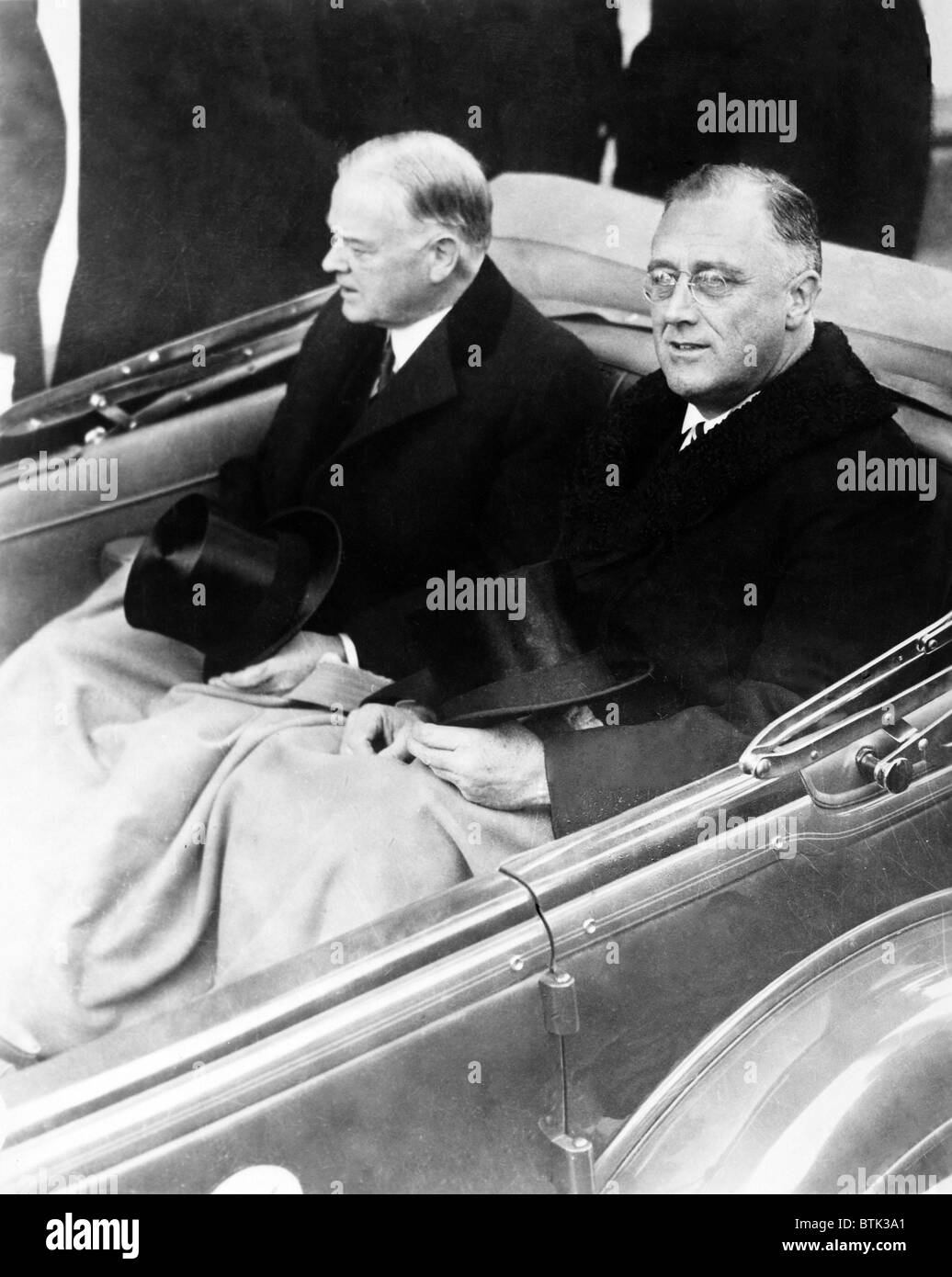 Franklin Delano Roosevelt and Herbert Hoover in on way to Roosevelt's inauguration. Hoover did not speak because Stock Photo