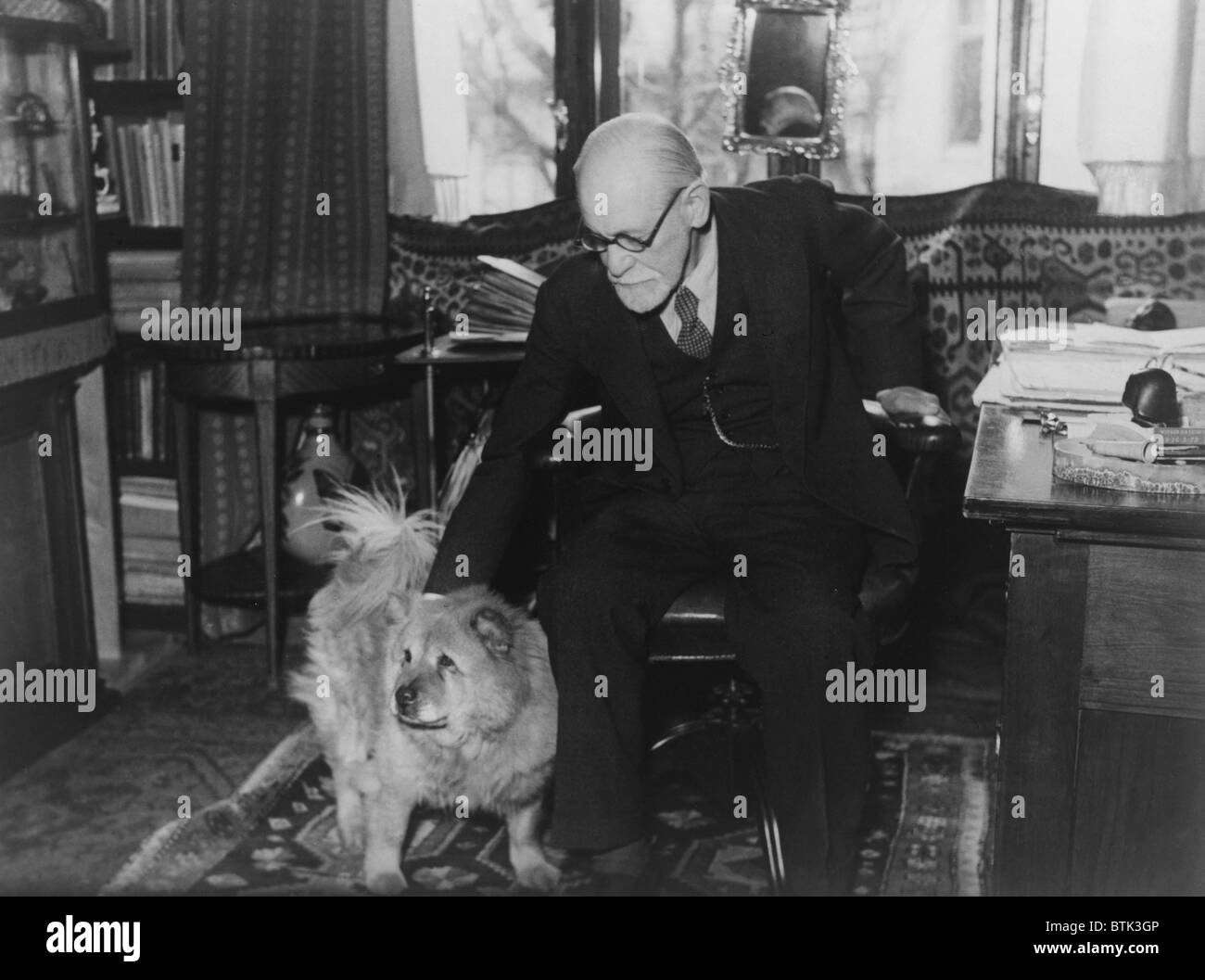 Sigmund Freud (1856-1939), seated in his study with his dog in 1937 photography by Princess Marie Bonaparte who - Stock Image