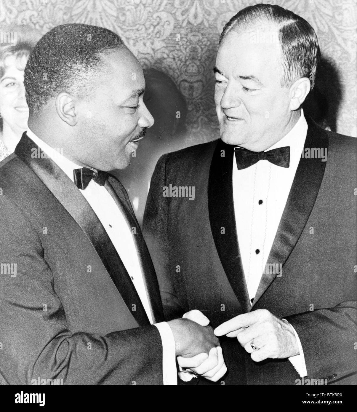 Martin Luther King, Jr. (1929-1968), chats with Vice-President Hubert Humphrey (1911-1978).  Humphrey was an early - Stock Image
