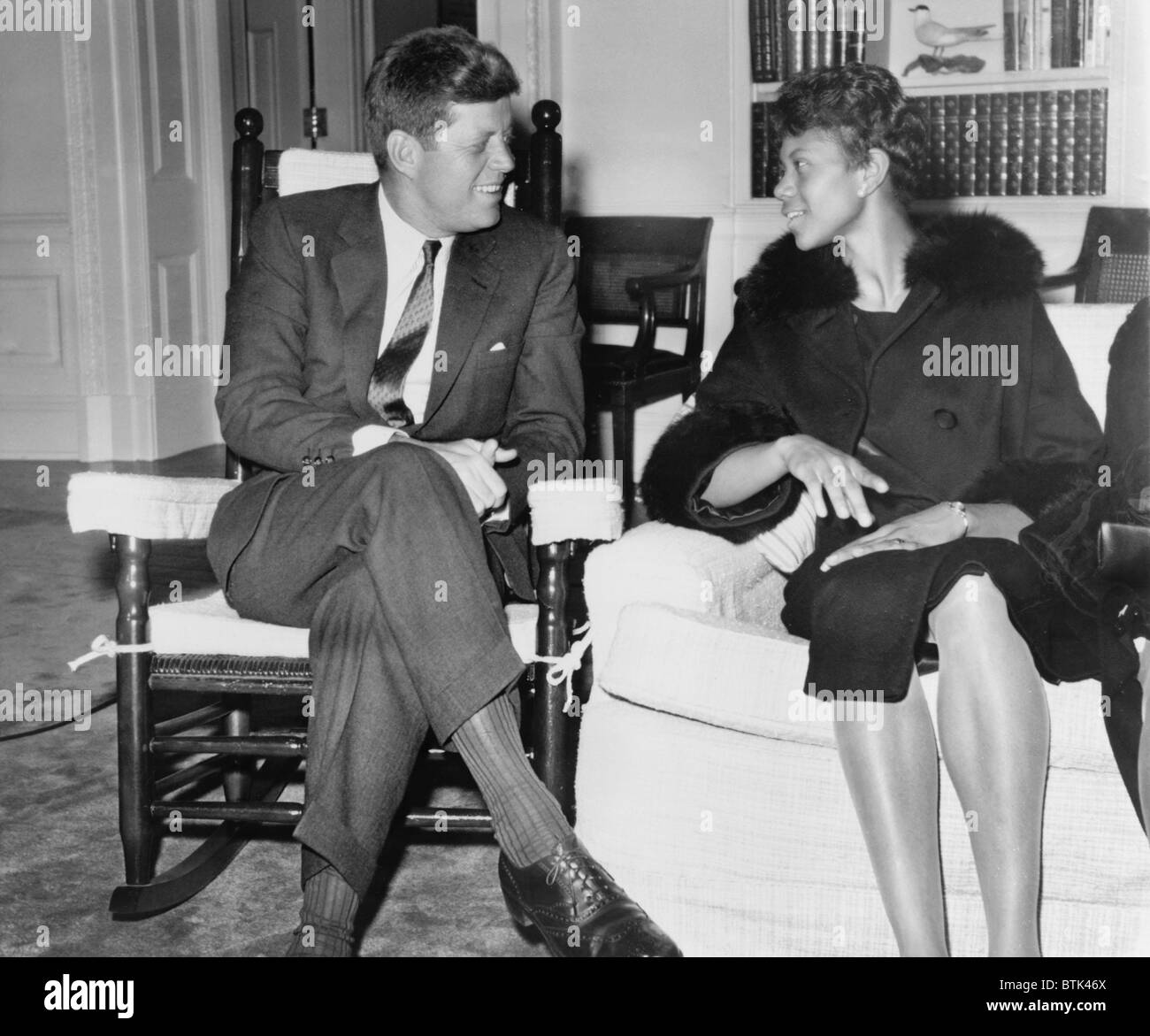 Wilma Rudolph (1940-1994) chats with President Kennedy at the White House. She was the first African American women - Stock Image