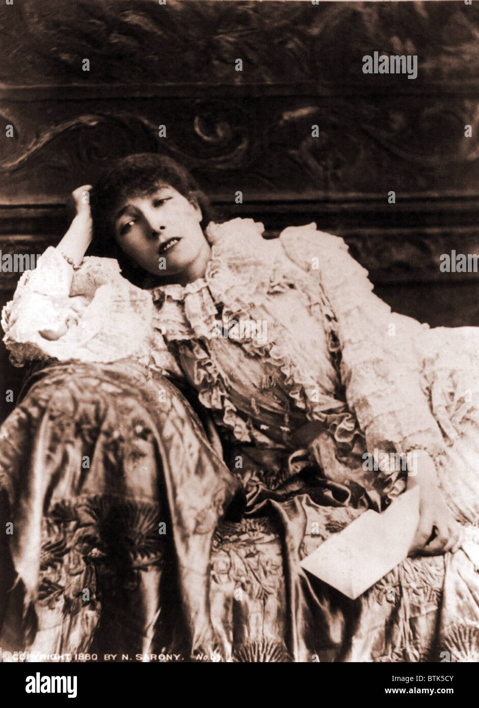 Sarah Bernhardt (1844-1923), French actress, reclining on a divan in an 1880's portrait. - Stock Image