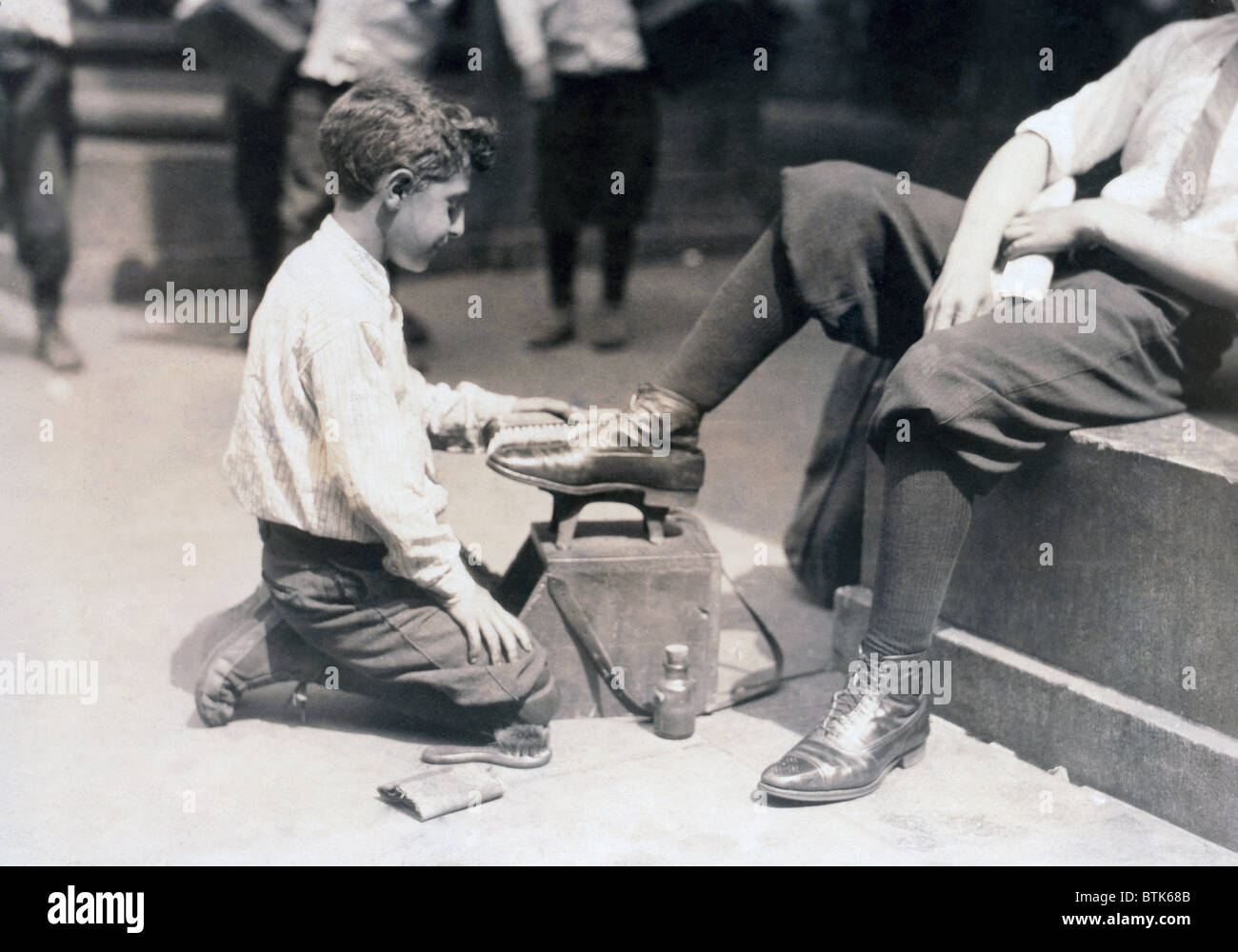 Child labor, Bootblack near City Hall Park, New York City. photograph by  Lewis Wickes Hine, July, 1924
