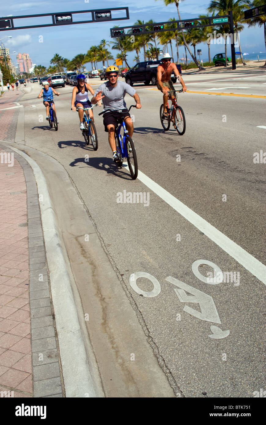 cyclists on seafront road Fort Lauderdale Florida USA Stock Photo