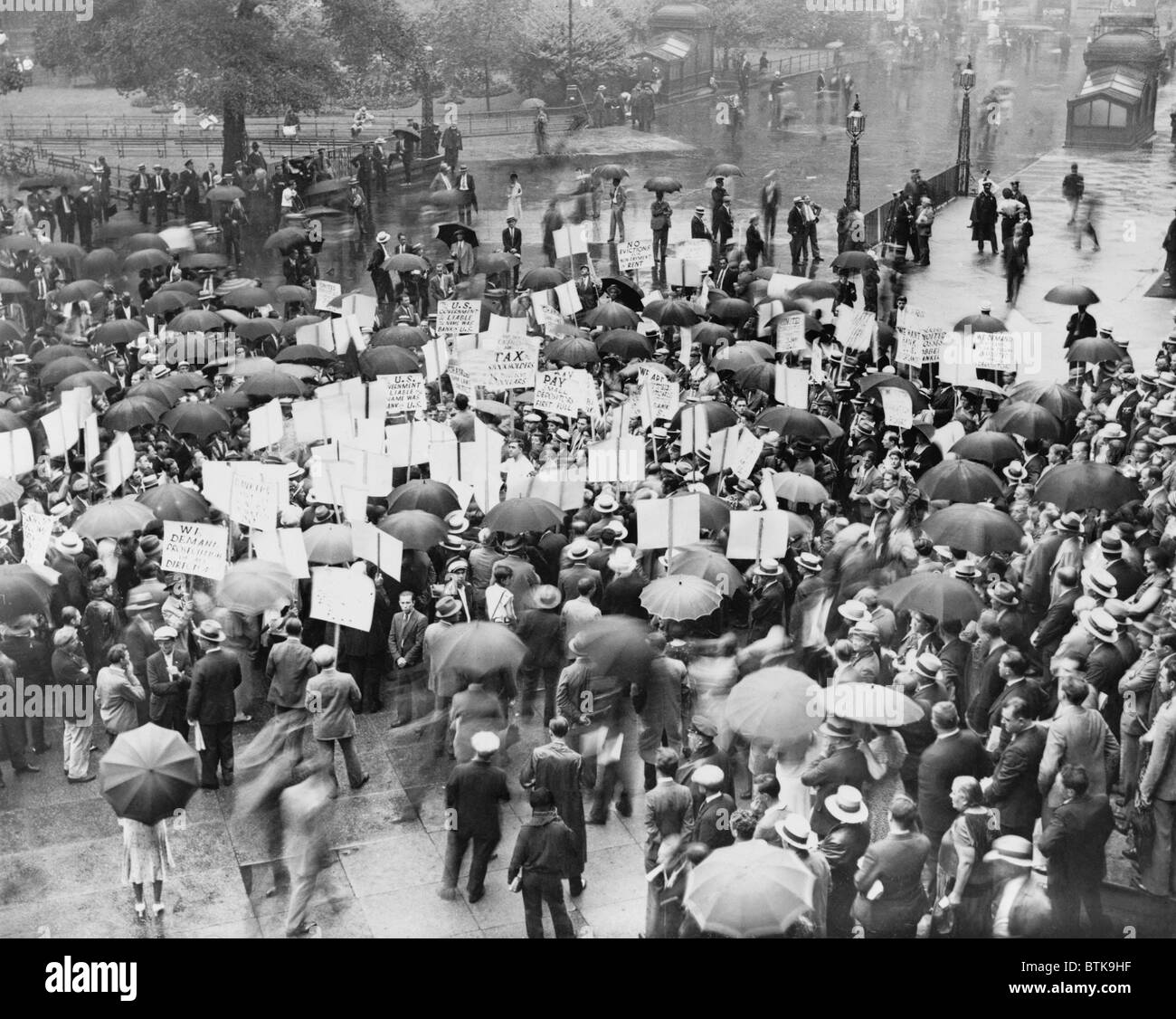 The Great Depression. A crowd of depositors protest in the rain at the Bank of United States after its failure. - Stock Image