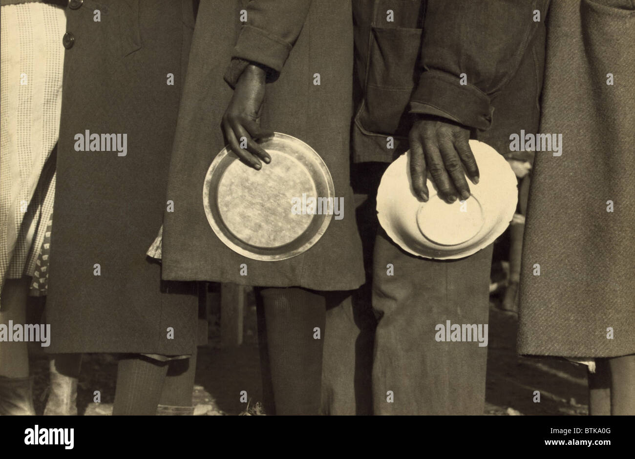 The Great Depression. African Americans in the lineup for food in the camp for flood refugees, Forrest City, Arkansas. - Stock Image