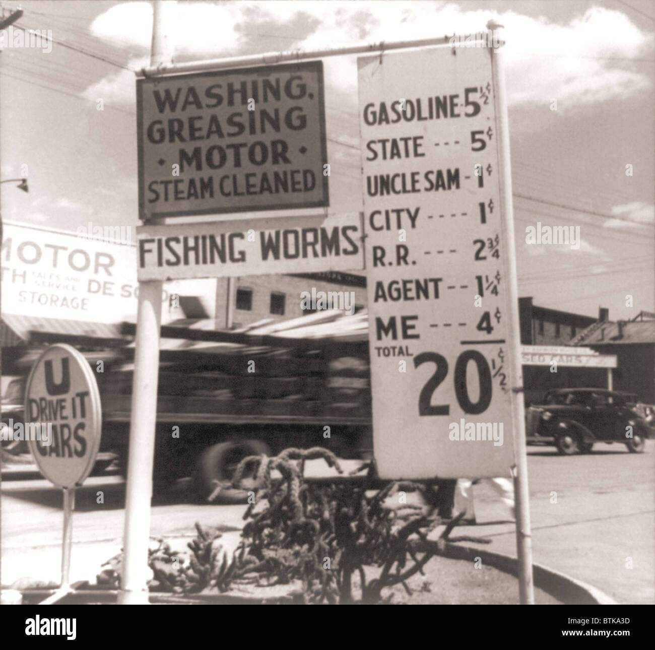 The Great Depression. Gas station sign itemizing taxes and fees imposed by different layers of government that raise - Stock Image