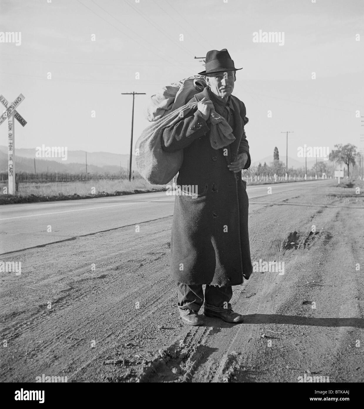 The Great Depression. Itinerant worker, traveling by foot, looking for work in mines, lumber camps, or farms. He - Stock Image