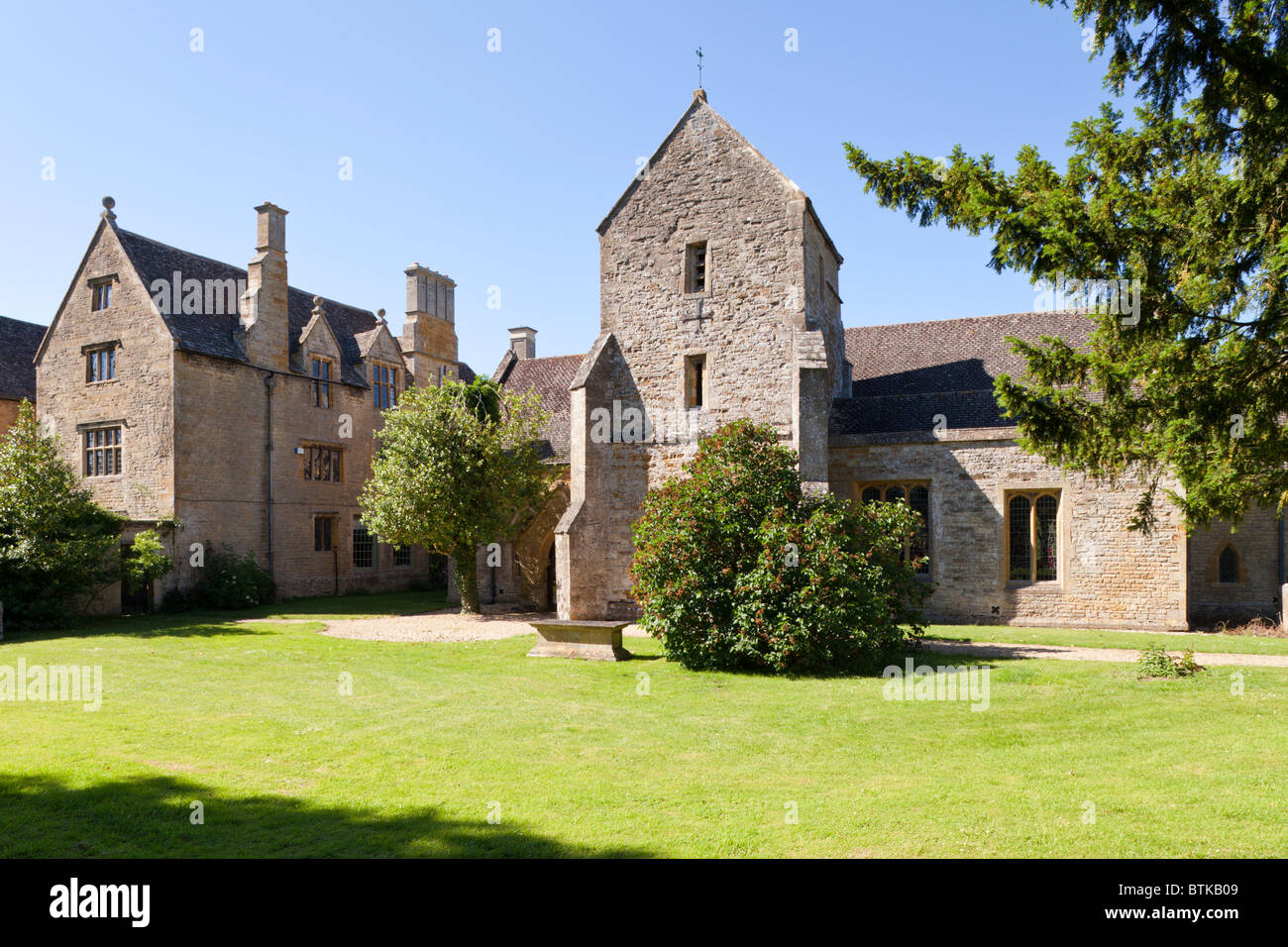St Denys church, next to the manor house, in the village of Little Compton, Warwickshire - Stock Image