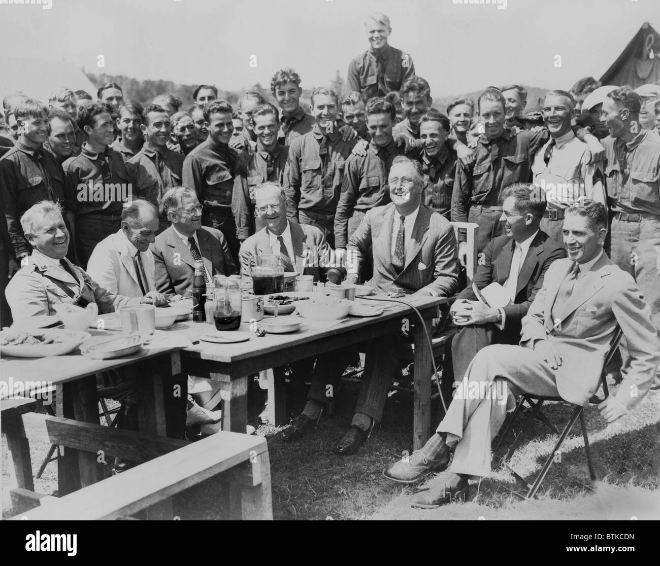 President Franklin D. Roosevelt having lunch at mess table in Camp Fechner, a Civilian Conservation camp, at Big - Stock Image