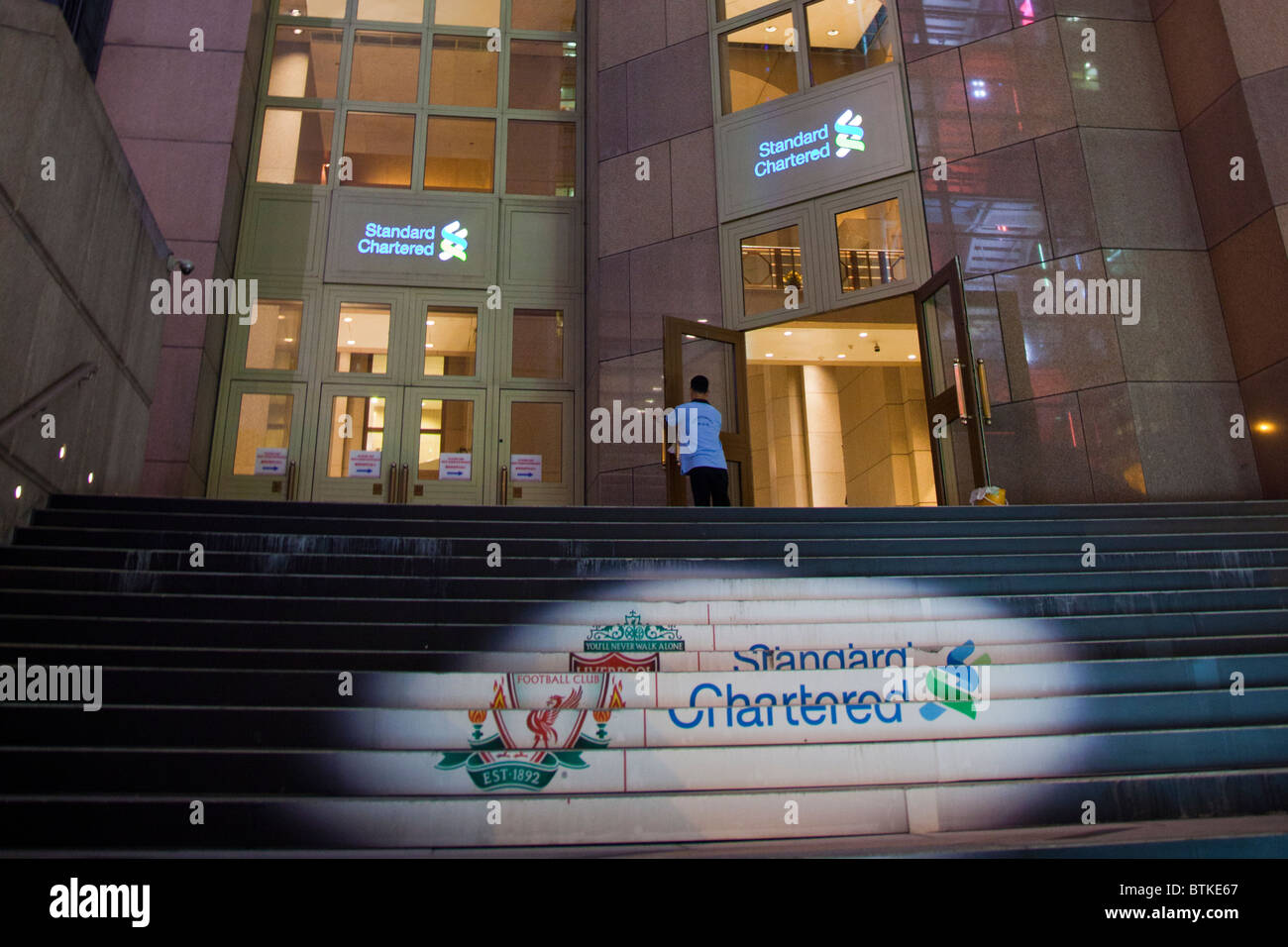 The Standard Chartered Bank building in Honk Kong, sponsors of Liverpool Football Club UK - Stock Image