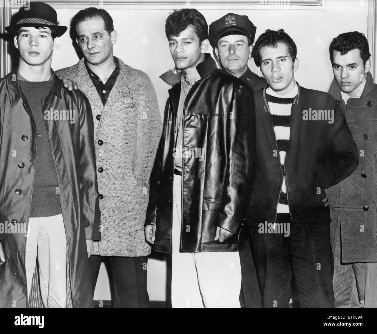 Teenage members of the Brooklyn Puerto Rican gang the Mau Maus, arrested in the fatal shootingof a rival gang member, - Stock Image