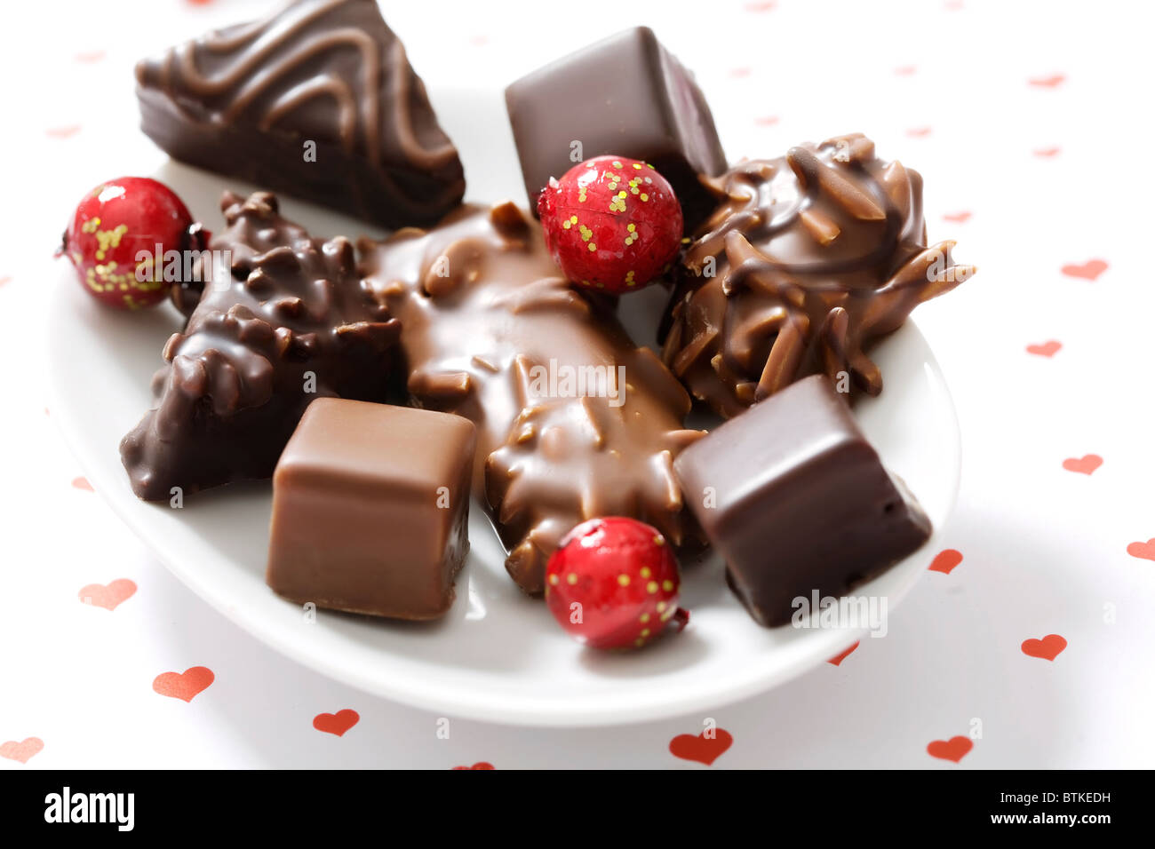 assortment of chocolate covered gingerbread with almonds and nuts - Stock Image