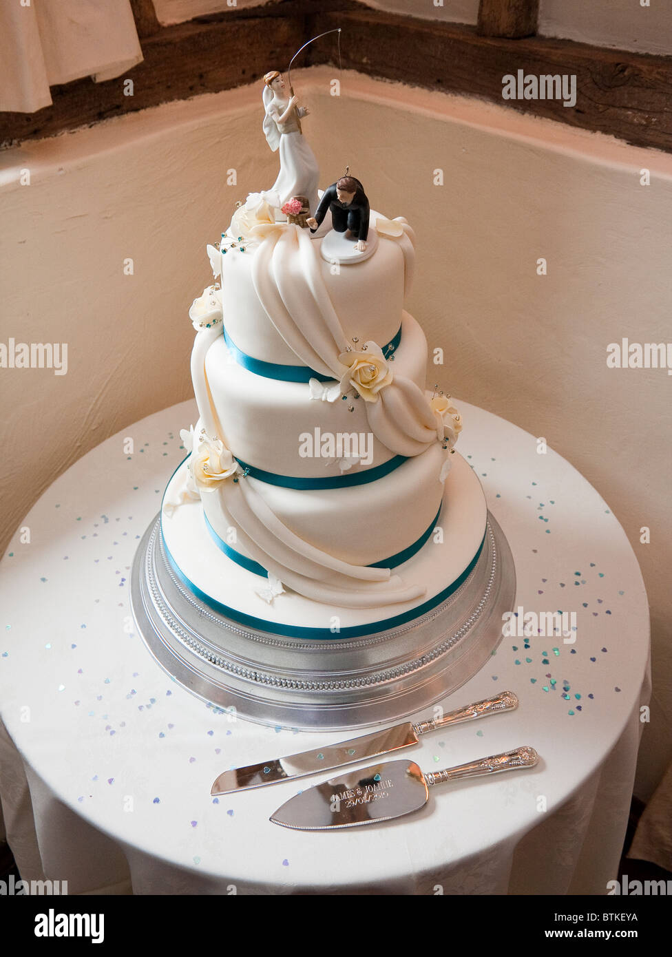 Wedding Cake Top Decoration Of Bride Catching Groom Stock Photo Alamy