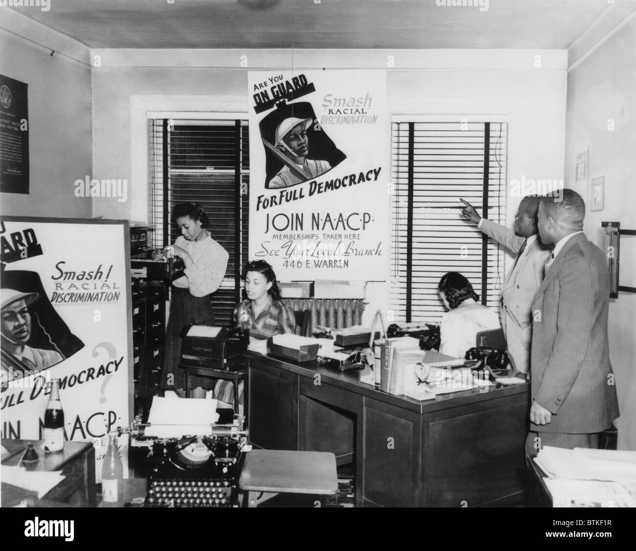 Interior view of NAACP branch office in Detroit, Michigan, showing NAACP membership drive posters picture an African - Stock Image