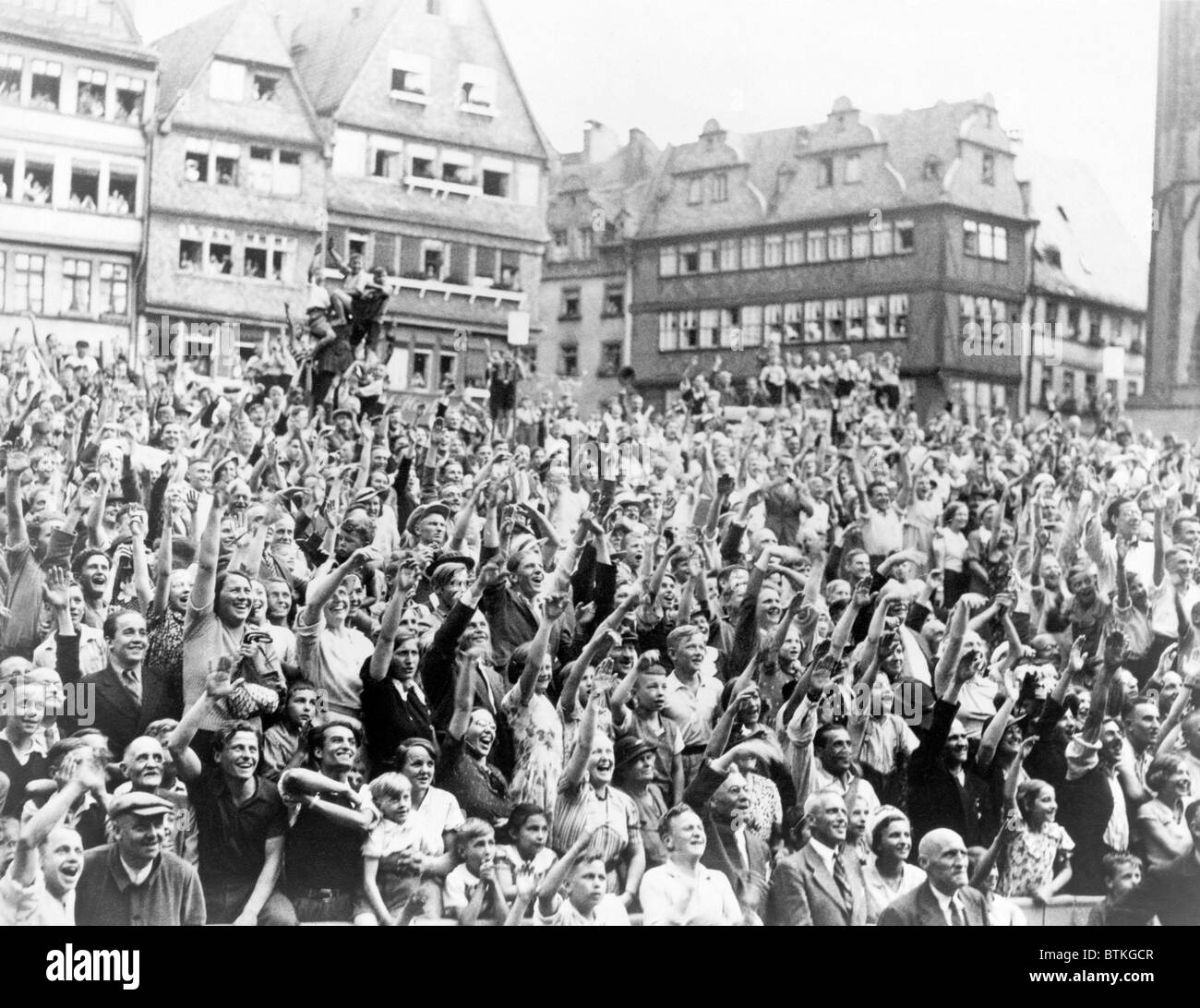 German admirers cheering Max Schmeling with a Nazi salute at City Hall in Frankfort, Germany. On June 19, 1936, - Stock Image