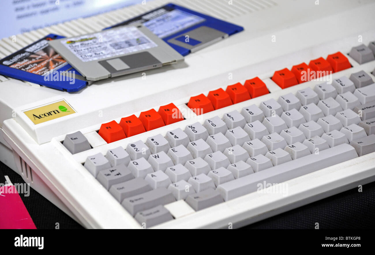 Acorn computer keyboard with floppy discs - Stock Image