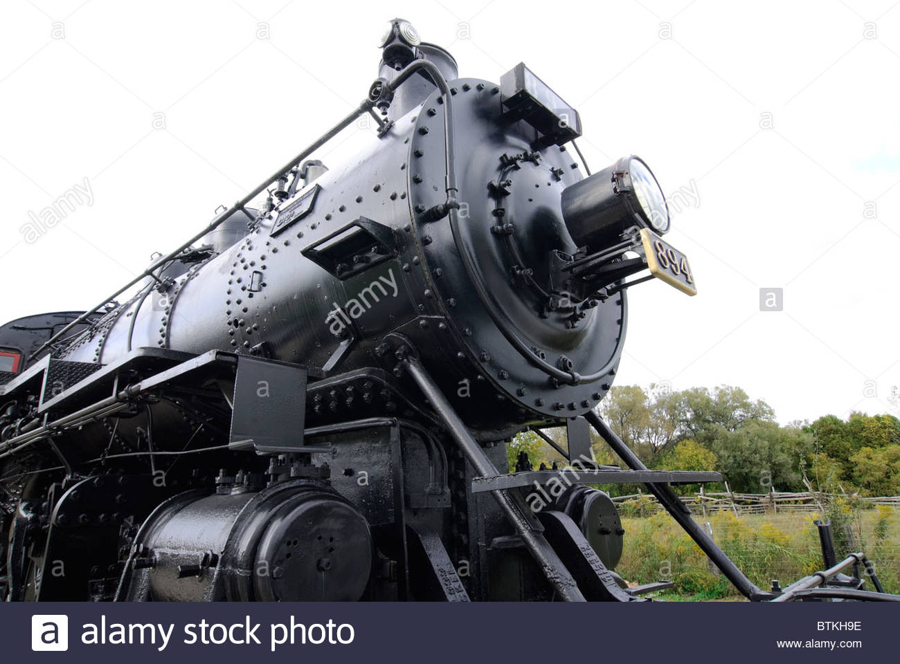 massive refurbished Canadian Railway steam locomotive on display in railroad museum Stock Photo
