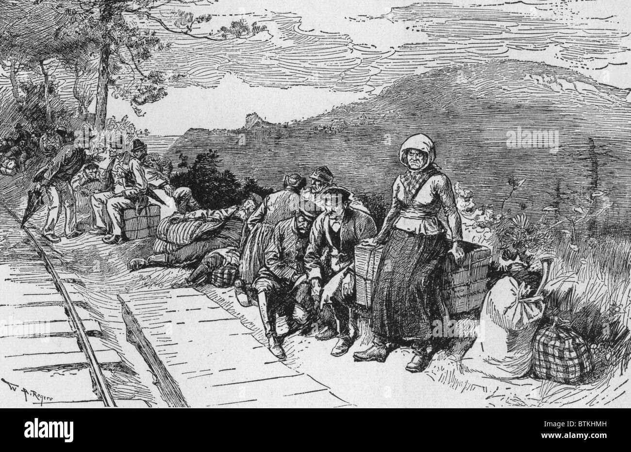 Newly arrived Slavic immigrants recruited to work in Pennsylvania coal mines wait for their train. After the U.S. - Stock Image