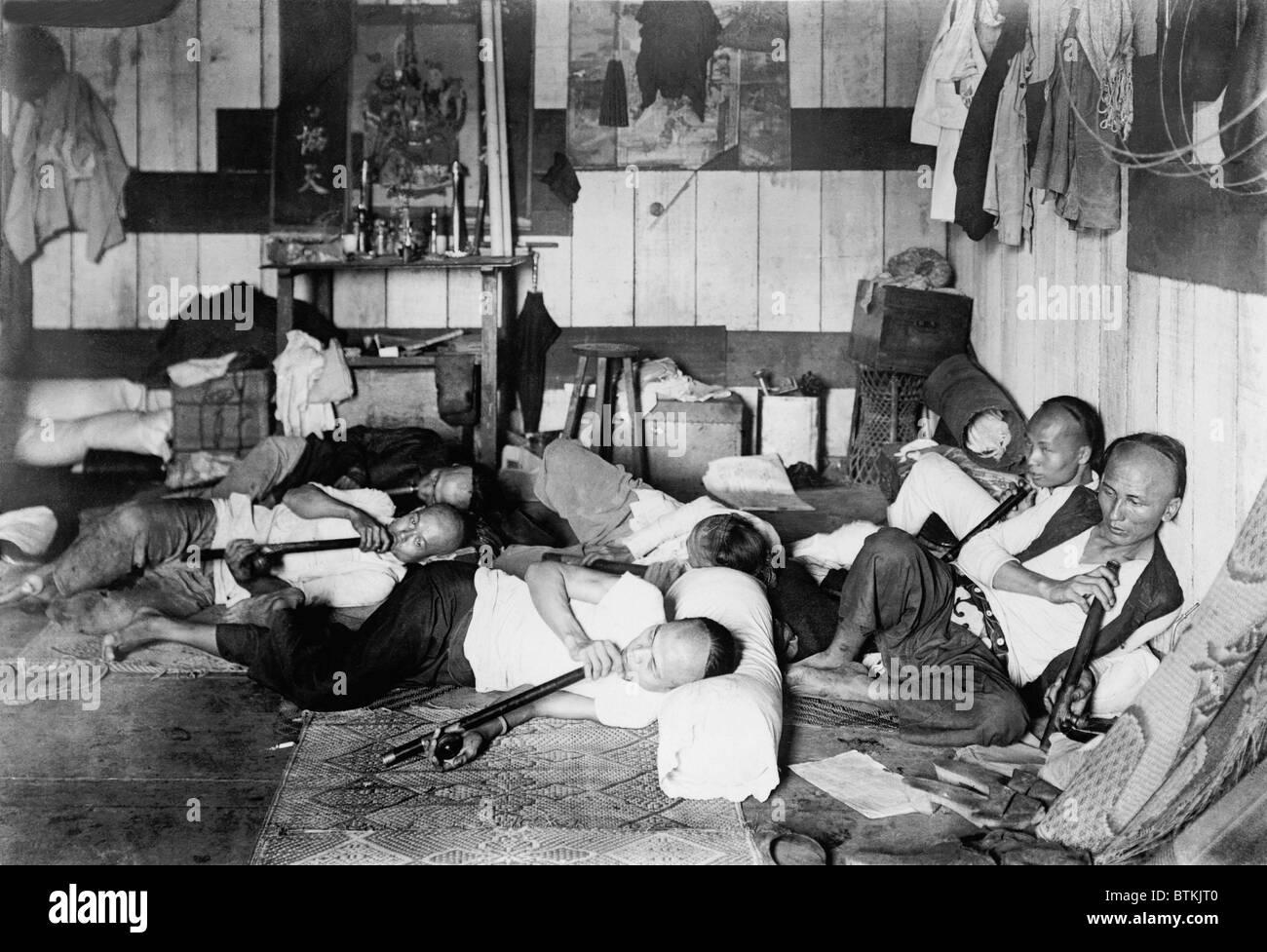 Ethnic Chinese smoking in an opium den in Manila, Philippine. 1924. - Stock Image