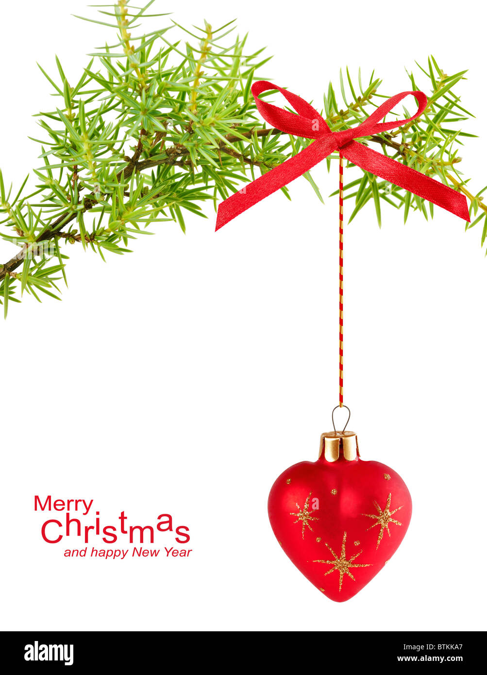 spruce branch with Christmas ball in the form of heart - Stock Image