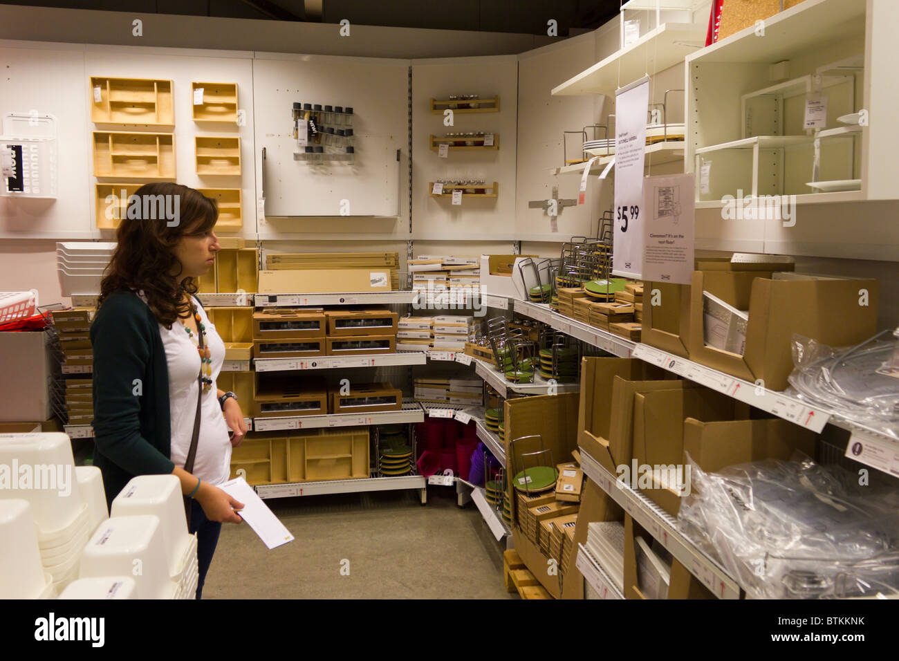 Girl looking at shelves ikea furniture warehouse store for Ikea locations plymouth meeting pa