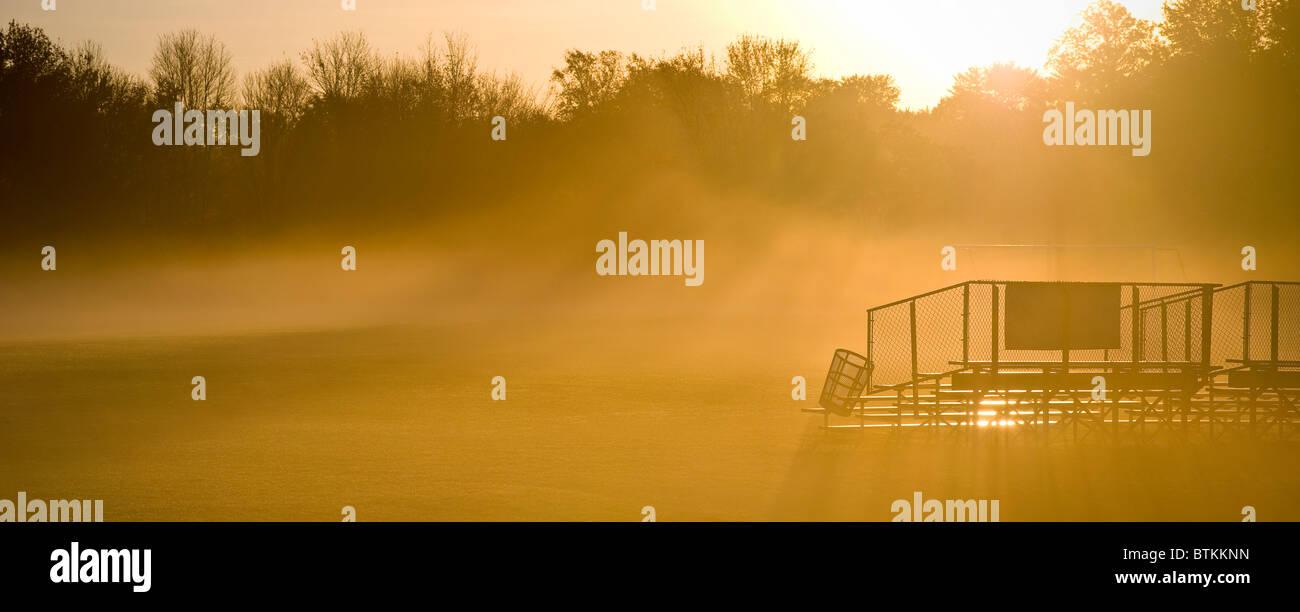 Sun Shining Through Fog On Football Field - Stock Image