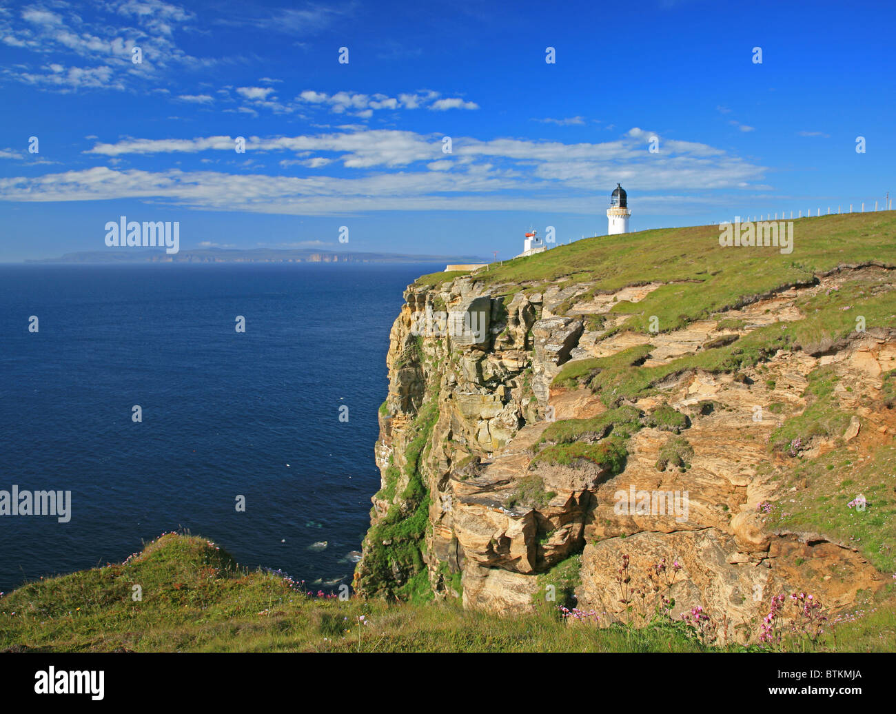 UK Scotland Caithness Dunnet Head and Lighthouse Looking over the Pentland Firth to Orkney and the island of Hoy - Stock Image