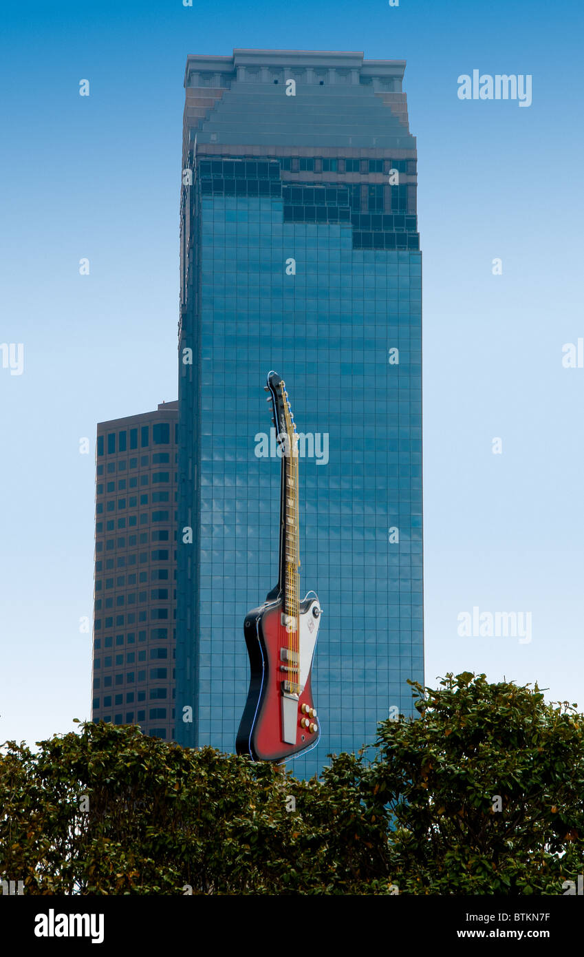 The 35-foot replica of the Stevie Ray Vaughan Gibson Firebird guitar at the Hard Rock Cafe in Houston, Texas, USA - Stock Image
