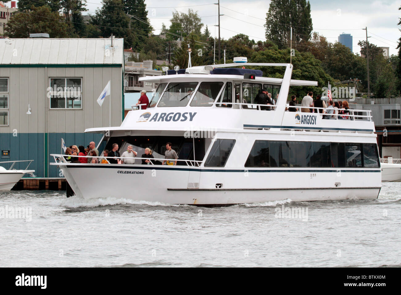 Argosy charter day cruise in Lake Union traveling to Lake Washington via the ship canal in Seattle. Passengers on - Stock Image