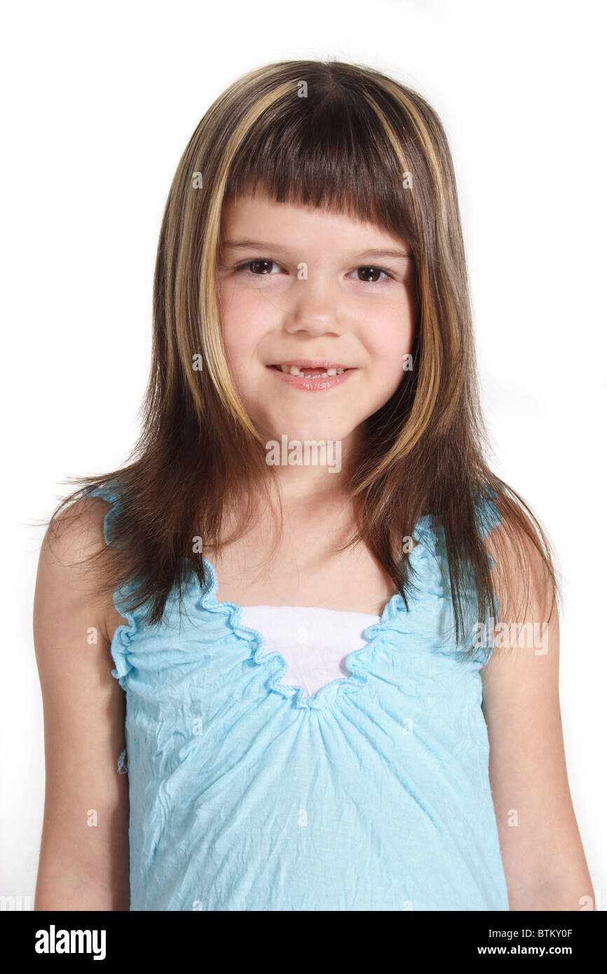 A smiling young girl. All isolated on white background. - Stock Image