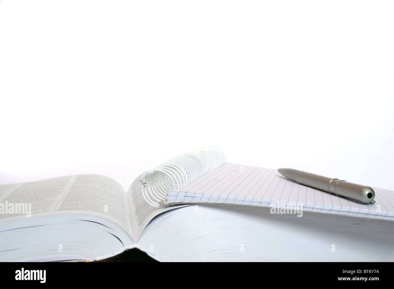 Schoolbook pen and paper to study. All isolated on white background - Stock Image