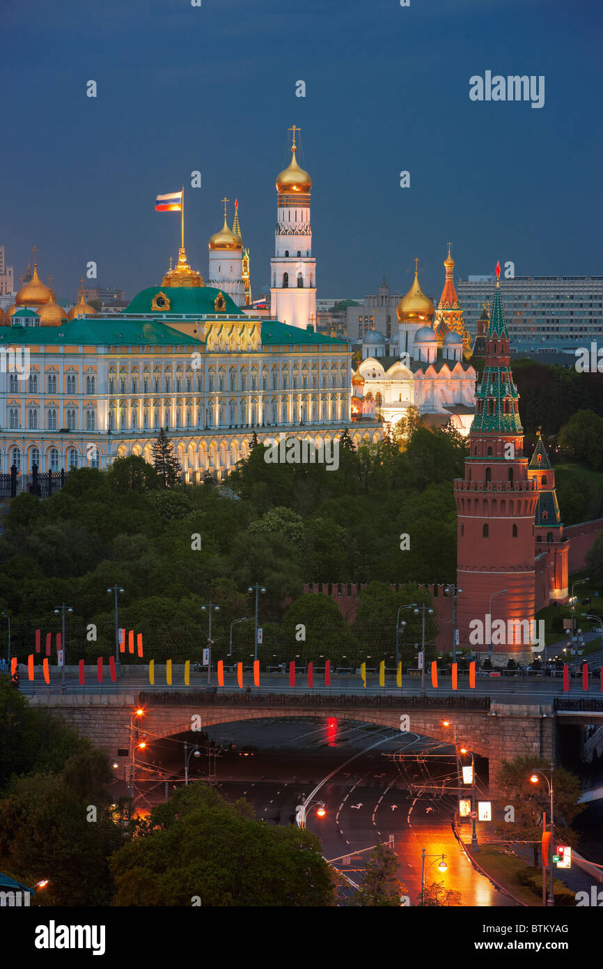 View of the Kremlin buildings illuminated at dusk. Moscow, Russia. - Stock Image