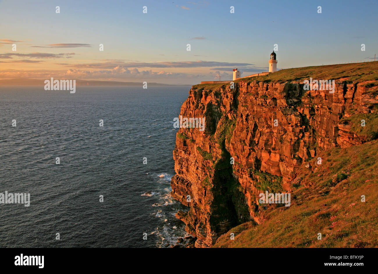 Evening light on the cliffs looking over the Pentland Firth to Orkney and the Island of Hoy Stock Photo