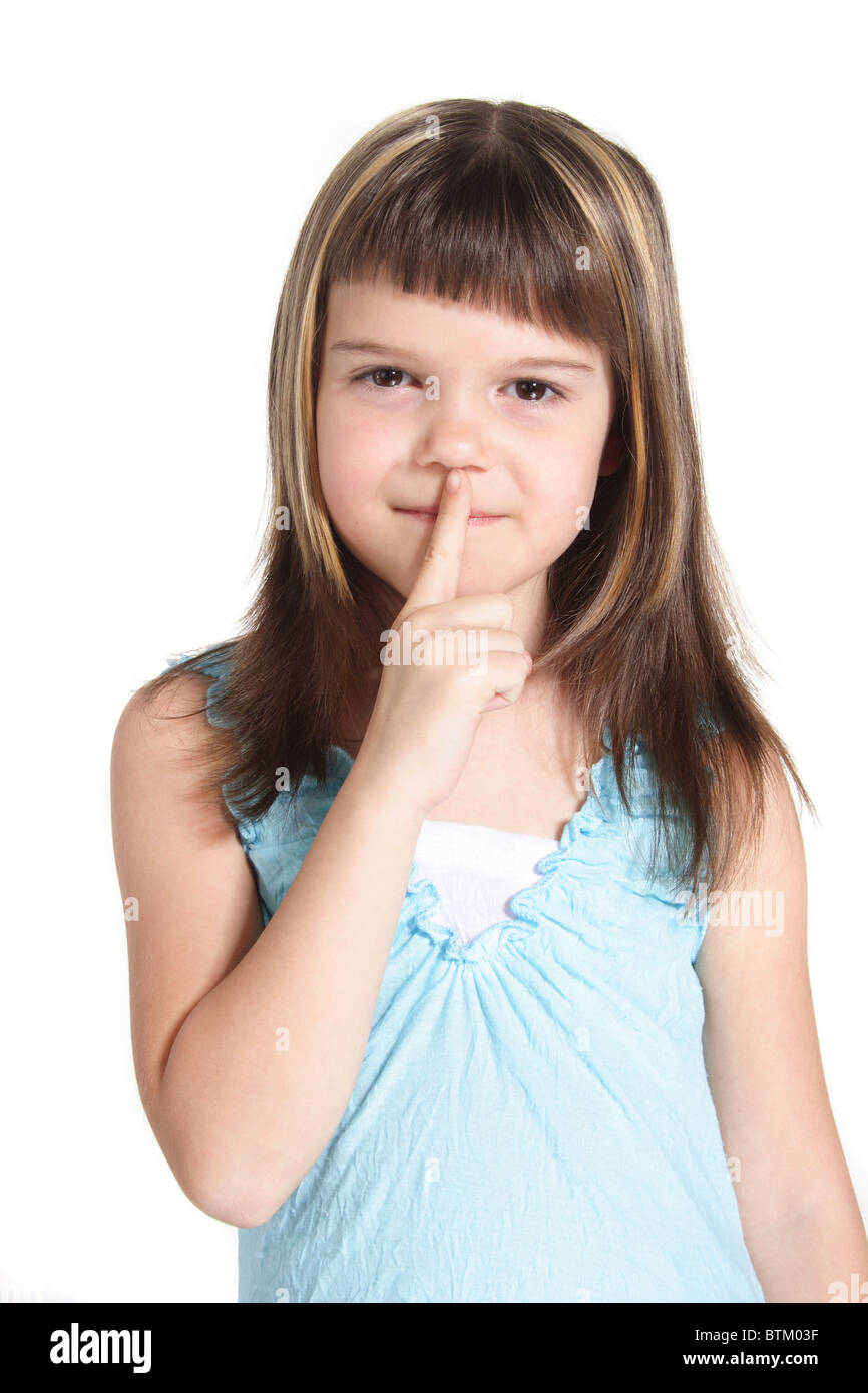 A young girl requests silence. All  isolated on white background. - Stock Image