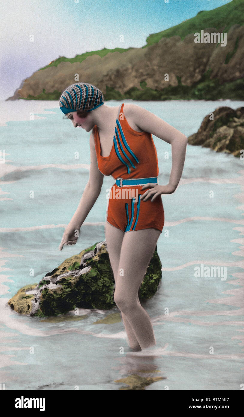 Historical photo (1910) of a woman on the beach - Stock Image