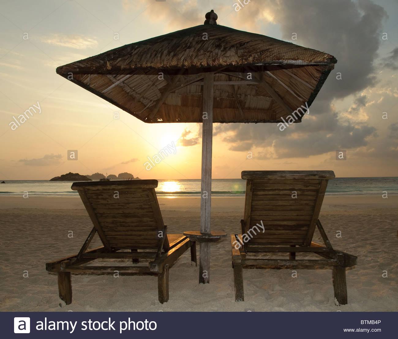 Two beach chairs at sunrise, Pulau Redang Island, Malaysia, Southeast Asia, Asia Stock Photo
