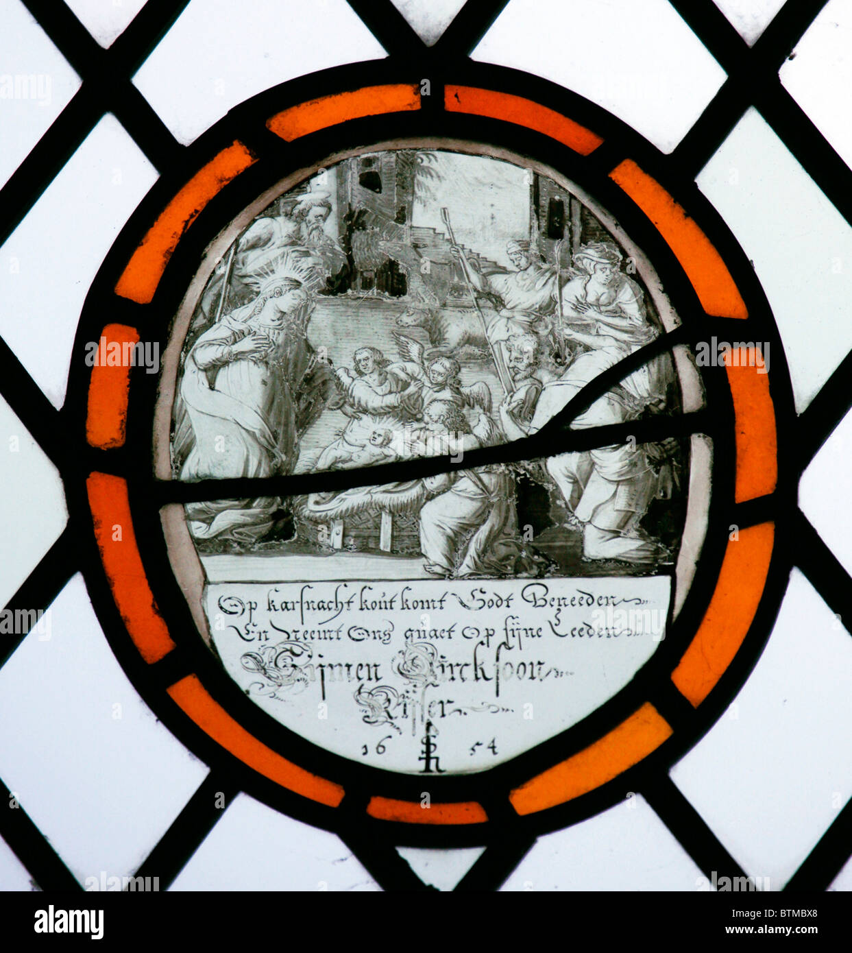 A Stained glass window depicting The Adoration of the Shepherds, Flemish School, 17th century - Stock Image