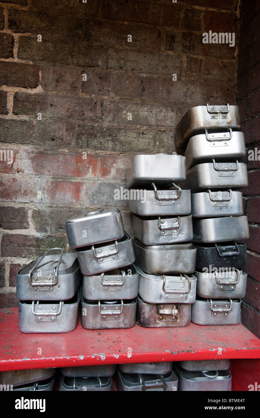 Surplus army mess tins stacked in Army Surplus store, Castle Road, Southsea, Portsmouth, Hampshiure, England. - Stock Image