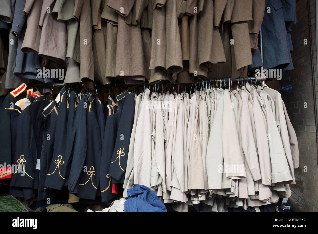 Racks of military clothing in Army Surplus Store Stock Photo