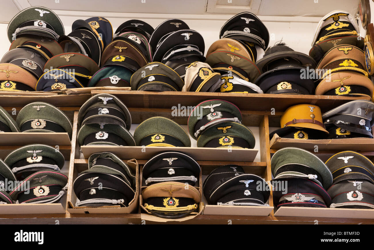 German military caps from ww2 in army surplus store. - Stock Image
