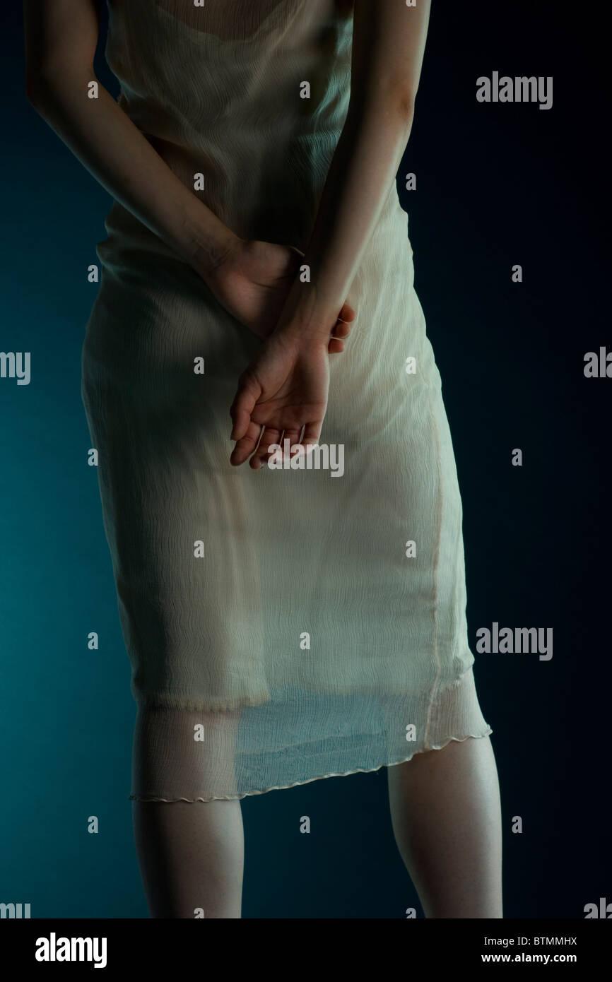 woman in sheer dress, drama, monochromatic, - Stock Image