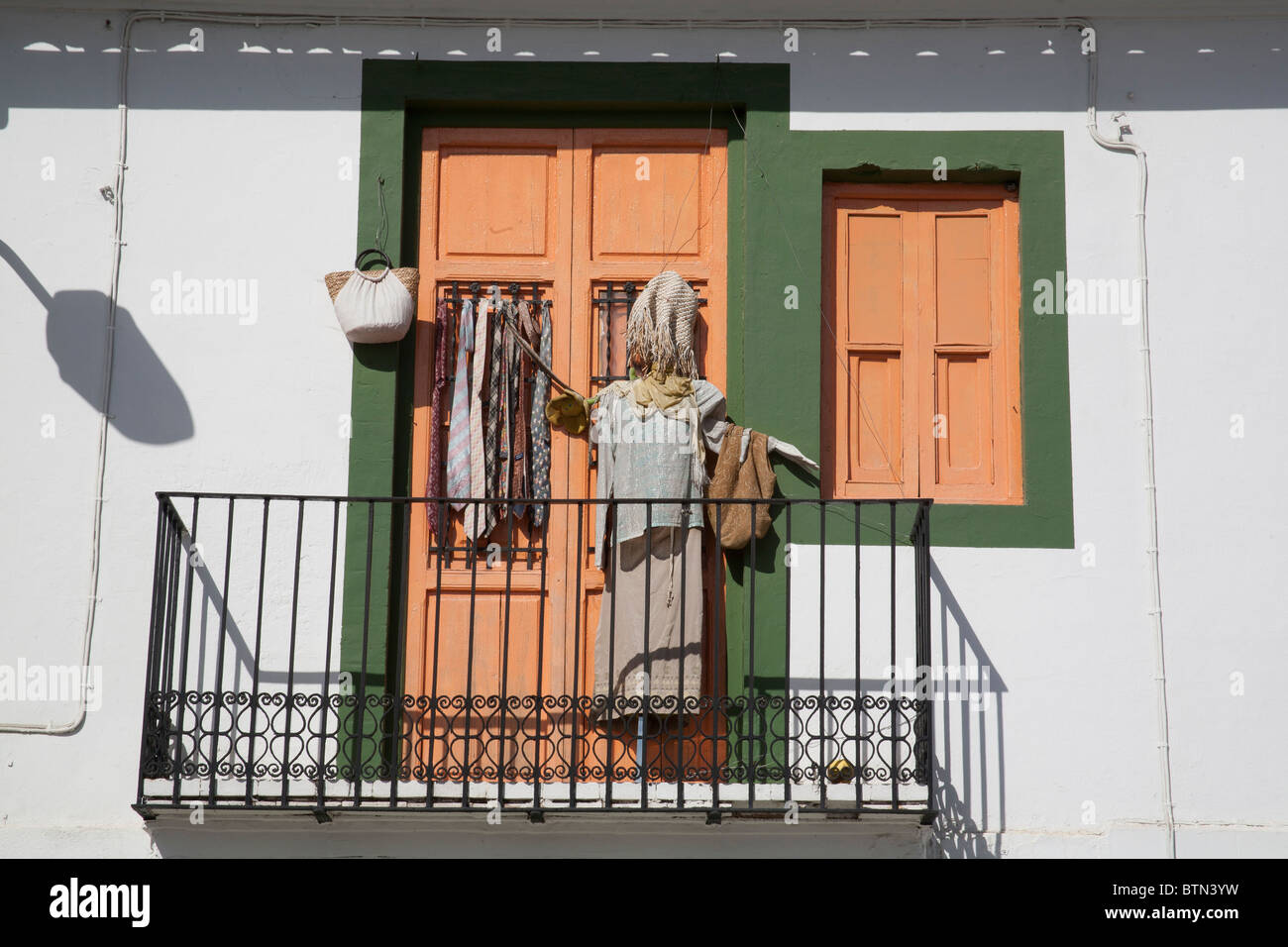 Display of clothes and ties outside a secondhand clothes shop in Valencia, Spain - Stock Image