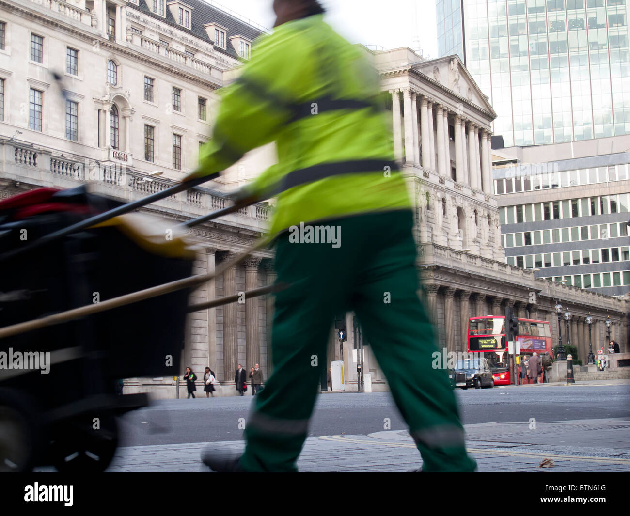 Street cleaner in the City of London - outside Bank of England - blurred motion - Stock Image