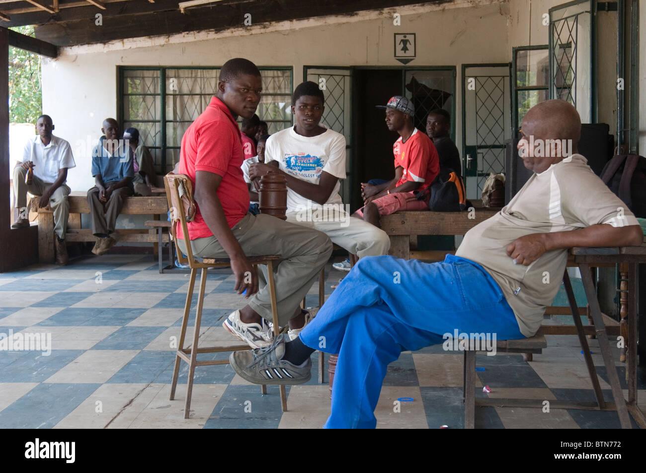 Patrons of the Falls Nightclub, a working man's bar in Victoria Falls, Zimbabwe - Stock Image