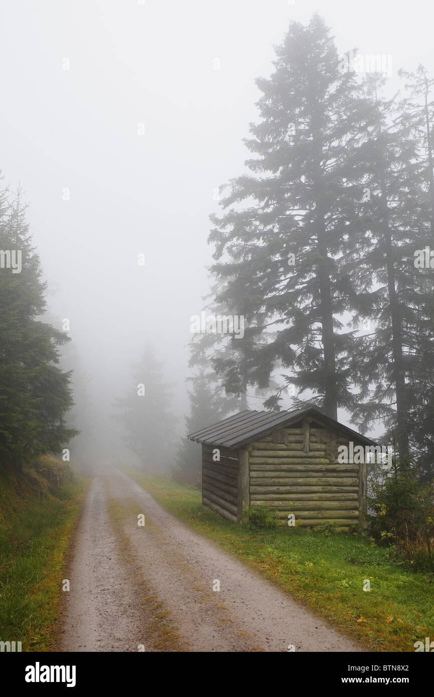 A path leads to a refuge over in the fog - Stock Image