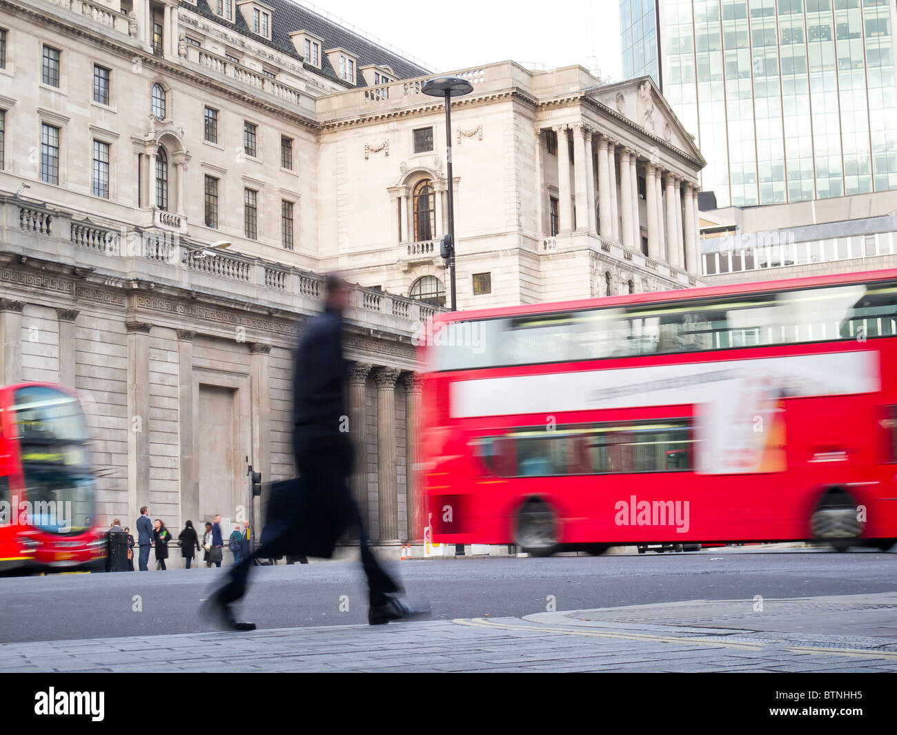 Motion blur traffic and people outside the Bank of England, City of London - Stock Image
