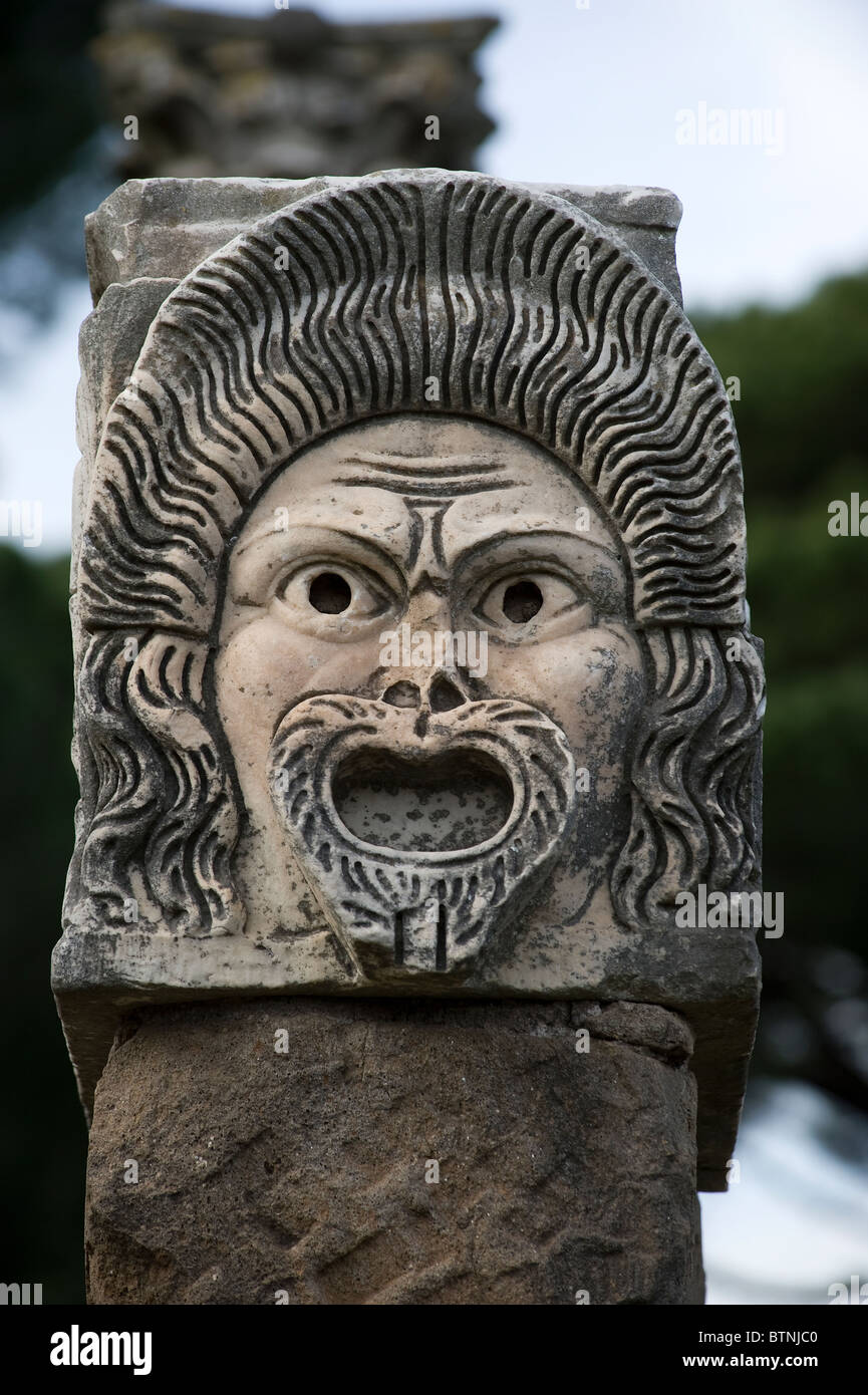 Stone mask in the ancient theater. Ostia Antica, Rome, Italy - Stock Image
